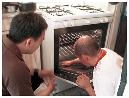 Toan and Jorge Munoz checking out his new oven.