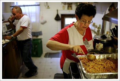 Jorge Munoz and his family help prepare meals each day to the hungry in Queens, NY.