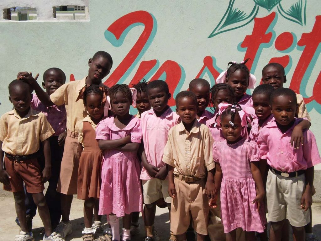 Students outside Institution Mahanaim High School in Grande Saline, Haiti