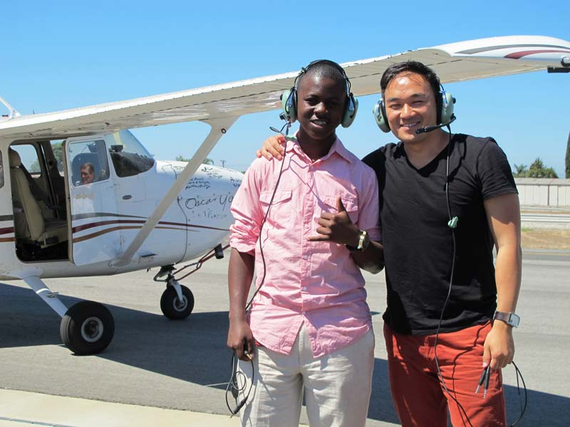 James Knox and Toan in front of an airplane.