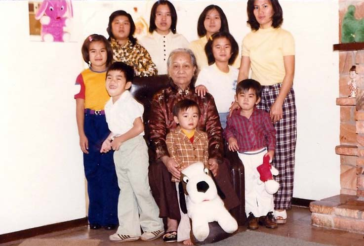 Family photo with Toan holding dog stuffed animal