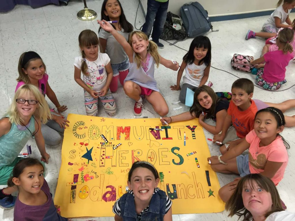 Community Heroes kids making a poster