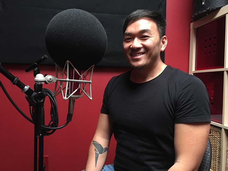Toan Lam in a podcast studio
