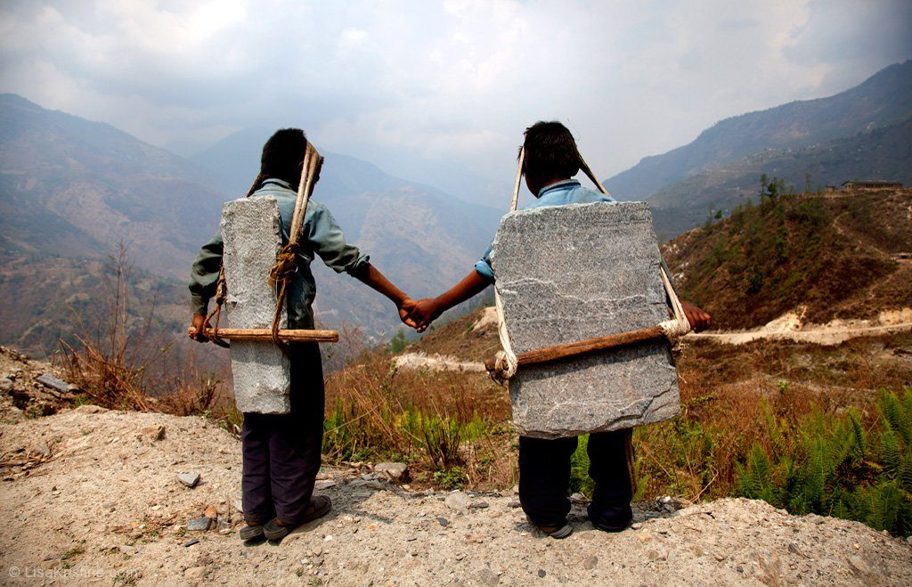 Children in Nepal carrying stones on their backs