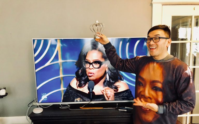Oprah Winfrey with a crown from Toan Lam