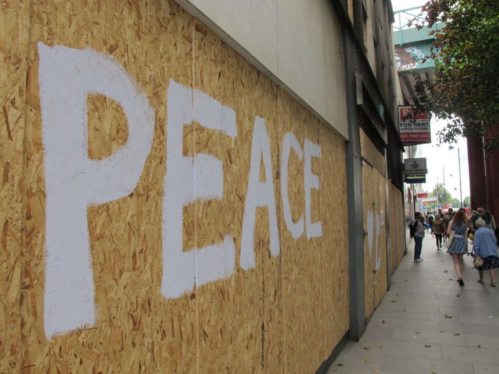 """""""Peace"""" written on boarded-up stores during the 2011 London riots."""