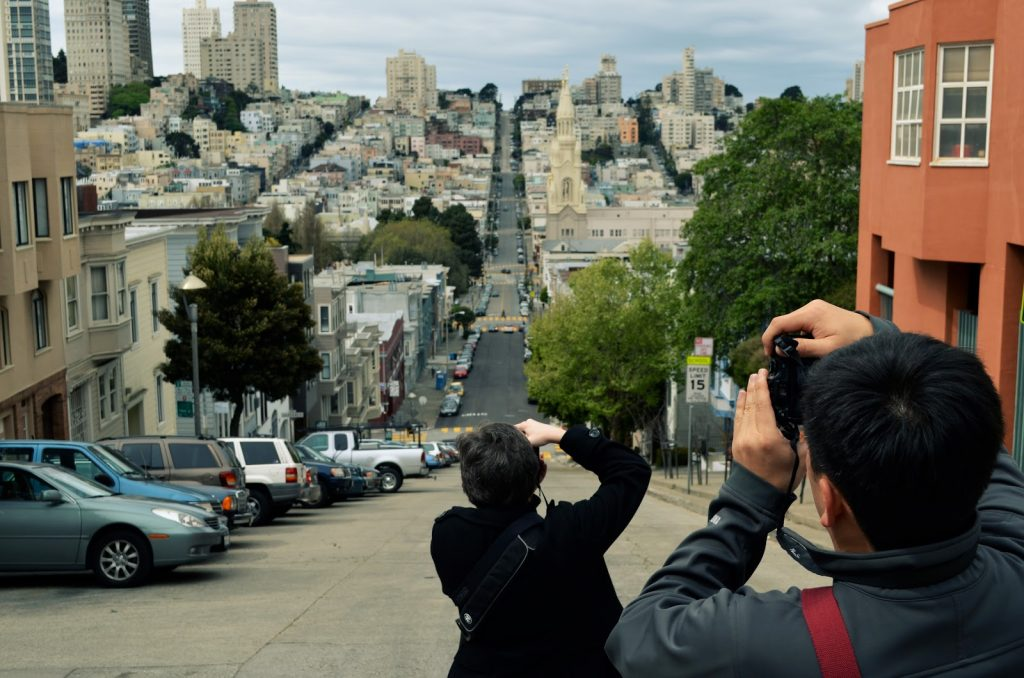 Kat Sloma and Toan Lam taking photos of San Francisco