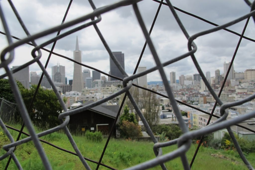 View of the Transamerica Pyramid through a chain-link fence