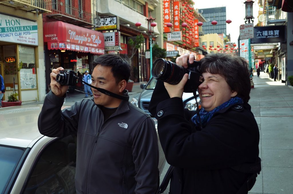 Toan Lam and Kat Sloma taking pictures in Chinatown