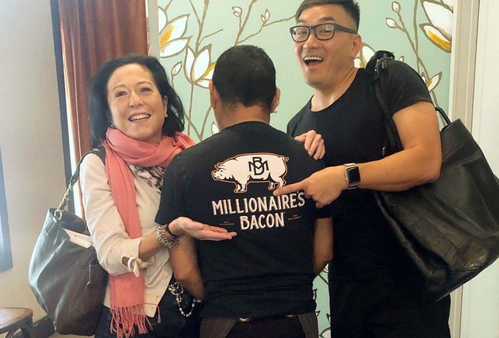 Maria Mercader enjoying Millionaire's Bacon at Sweet Maple in San Francisco.