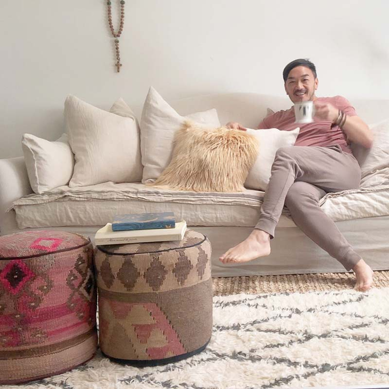 Toan and his new sofa with pillows he custom designed.